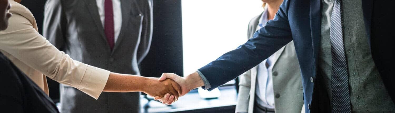 austin financing meeting shaking hands